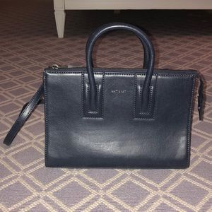 navy handbag with strap